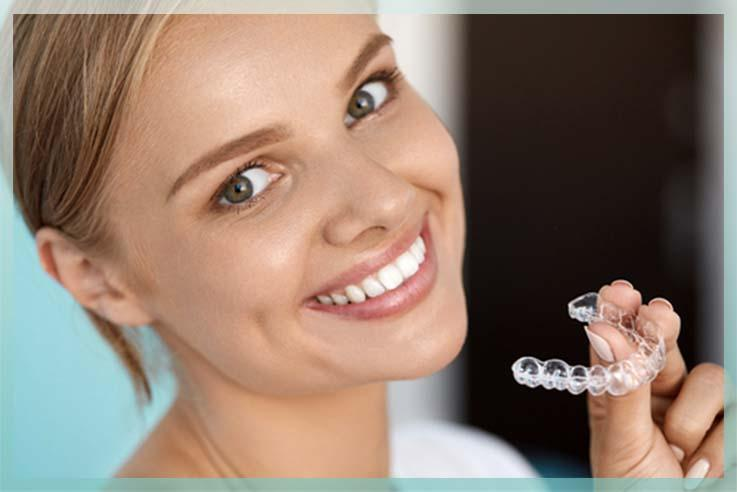 picture of lady with invisalign tray